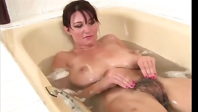 Darkhaired Vanessa In Bathroom Rubs Her Hairy Pussy