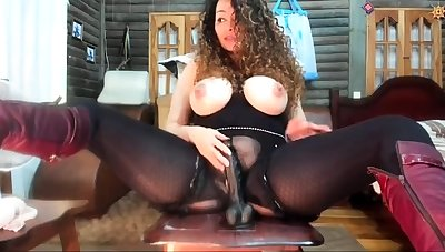 Busty brunette MILF toys the brush marketable pussy