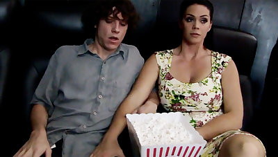 Sex-mad milf touch shy stepson's dick in cinema
