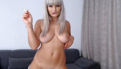 Sexy blonde smoking and dancing