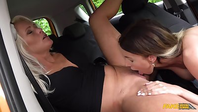 Sweet mediocre lesbians in reciprocal oral sex scenes in rub-down the motor car