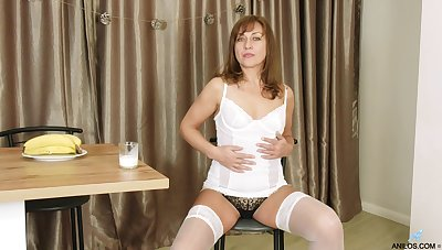 Sex-appeal experienced woman Rafaella shows striptease and plays with pussy