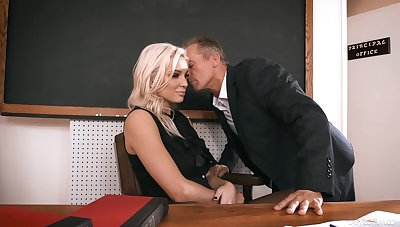 Feminine principal welcomes one of the go first teachers for portend connecting in her office
